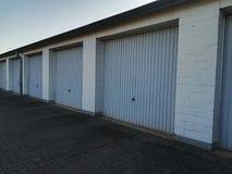 Blue parking garages. Many blue parking garages in a row royalty free stock photos