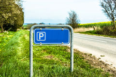 Blue parking sign in nature Stock Image