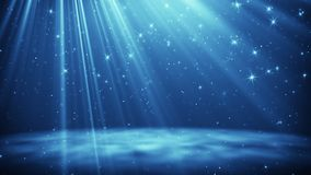 Blue particles and stars flying in light rays. Abstract holiday image. Computer generated graphic Royalty Free Stock Photography