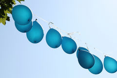 Blue party balloon floating in the air Royalty Free Stock Photos