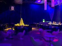 Blue party lighting. A view of a room set for a Christmas party with funky blue lighting for atmosphere stock images