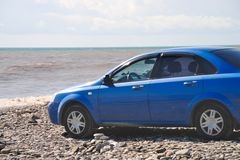 Car on the beach pebble Stock Image