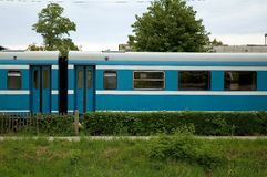 Blue passenger train Stock Photos