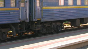 Blue Passenger Train. Leaves the Station stock footage
