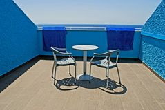 Blue patio with the ocean view. Terrace painted in blue with a view on the ocean Royalty Free Stock Photos