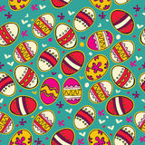 Blue pattern with colorful Easter eggs. Stock Image