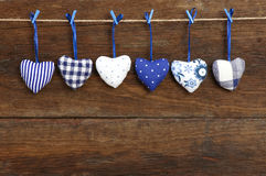 Blue pattern Gingham Love Valentine's hearts hanging on wooden t Royalty Free Stock Image