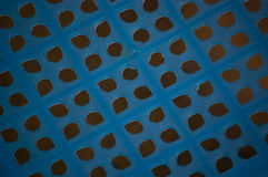 Blue pattern. Holes of plastic small chair look alike blue flower Stock Photos