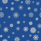 Blue pattern with snowflakes Stock Photos