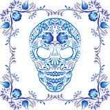Blue patterned skull with flowers in a frame. Stock Image