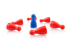 Blue pawn standing among fallen red pawns Royalty Free Stock Photos