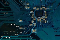 Blue pcb board circuit close up technology background. Back side of blue pcb board circuit close up technology background with selective focus and some dust on stock photo