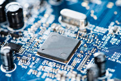 Blue PCB with a lot of elecric components Stock Images