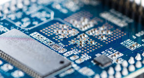 Blue PCB. With SMD components (detailed close-up shot Stock Photo