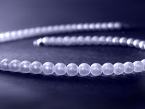 Blue pearls. Close-up of a blue pearls necklace Stock Photos
