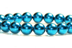 Blue pearls. Isolated on white background Stock Photography