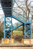Blue pedestrian bridge over railroad Stock Photo