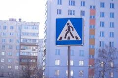 Blue pedestrian crosswalk sign on a  street Royalty Free Stock Photos