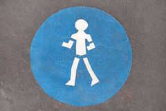 Blue pedestrian sign on road Royalty Free Stock Photos
