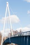 Blue pedestrian suspension bridge Stock Photo