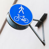 Blue pedestrian zone road sign. On building wall stock images