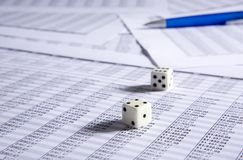 Blue pen and dice royalty free stock photos