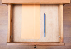 Blue pen and envelope in open drawer Royalty Free Stock Photography