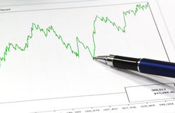 Blue pen and a line graphic Royalty Free Stock Photo