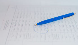 Blue pen lying on paper documents. Economic Papers, isolation blue ink Royalty Free Stock Photo
