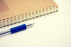 Blue pen on notebook vintage tone.  Stock Images