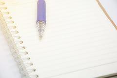 Blue pen on notebook vintage tone Stock Photos
