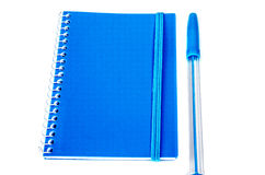 Blue pen and notebook. On a white background Stock Photos