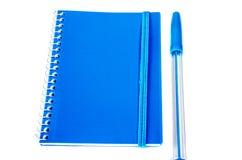 Blue pen and notebook Stock Photos