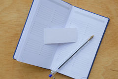 A blue pen and small weekly planner Stock Images
