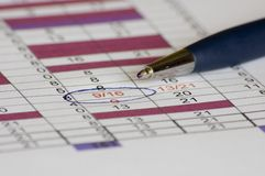 Blue pen on work plan Royalty Free Stock Photos