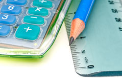 A blue pencil with a calulator and ruler Stock Photo