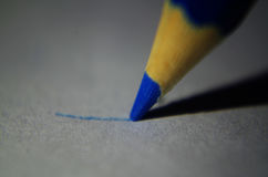 Blue pencil. Close-up draws the line royalty free stock photo