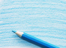 Blue pencil with coloring on a paper Royalty Free Stock Photography