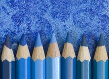 Blue pencil crayons. With different shades royalty free stock photos