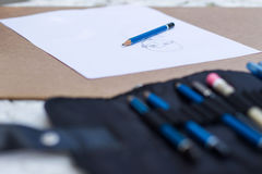 Blue pencil with drawing paper Royalty Free Stock Images