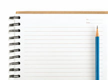 Blue pencil on empty notebook isolate Stock Images