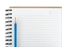 Blue pencil on empty notebook isolate Royalty Free Stock Image