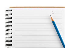 Blue pencil on empty notebook isolate Royalty Free Stock Images