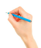Blue pencil in hand Stock Photos