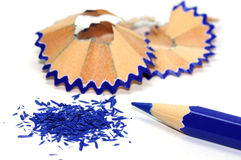 Blue pencil with its shavings Stock Image
