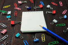 Blue pencil,notebook,colorful stamp paper clip o Stock Photos