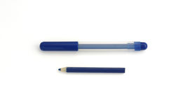 Blue pencil and pen Stock Images