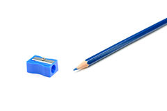 Blue pencil and a pencil sharpener Royalty Free Stock Photos