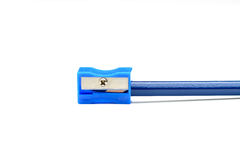 Blue pencil and a pencil sharpener Royalty Free Stock Image