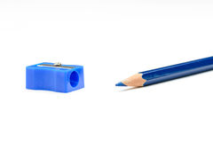 Blue pencil and a pencil sharpener Stock Photography